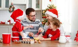 Happy family bake christmas cookies. Happy funny mother and children bake christmas cookies royalty free stock images