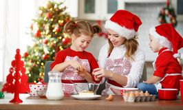 Happy family bake christmas cookies. Happy funny mother and children bake christmas cookies stock photo