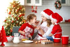 Happy family bake christmas cookies. Happy funny mother and children bake christmas cookies royalty free stock image