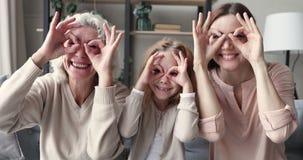 Happy funny multigenerational women family have fun make binoculars