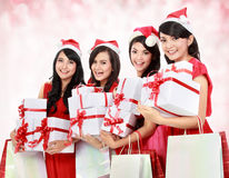 Happy funny people with christmas santa hat holding gift boxes a Royalty Free Stock Photos