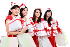 Happy funny people with christmas santa hat holding gift boxes a Stock Photography