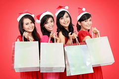 Happy funny people with christmas santa hat holding gift boxes a Stock Photos