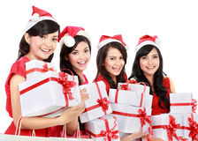 Happy funny people with christmas santa hat holding gift boxes Stock Images