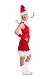 Happy and funny santa girl. Cute young girl in santa dress and with two pigtails Royalty Free Stock Photo