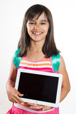 Happy and funny school girl holding a tablet Stock Images