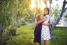 Happy funny sisters embrace together Stock Image