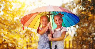 Happy funny sisters twins child girl with  umbrella in autumn Stock Photo