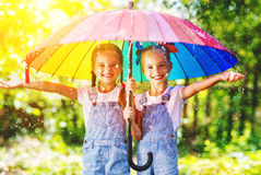 Happy funny sisters twins child girl with  umbrella Stock Photography