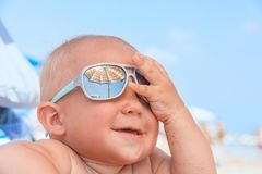 Happy funny smiling cute baby boy with sunglasses stock photos