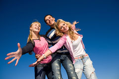 Happy funny team. Family aganist the blue sky Royalty Free Stock Photography
