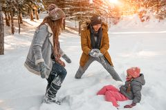 Wintertime. Happy funny winter family action stock images