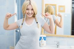 Happy woman having braided blonde hair stock image