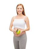 Happy future mother with green apple Royalty Free Stock Photos