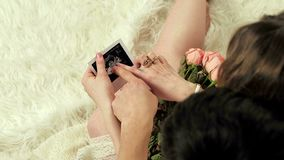 Happy future parents looking at pregnancy ultrasound photo stock video footage