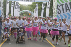 Happy Gaggle of Color Run Racers Take Off Stock Photo