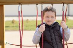 Happy games - pretty happy boy on the playground Stock Photography