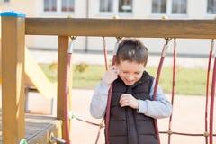 Happy games - pretty happy boy on the playground Stock Photos