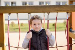Happy games - pretty happy boy on the playground Stock Photo