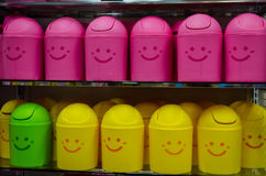 Happy garbage bins. Colorful happy garbage bins on a store shelf Stock Images