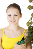 Happy gardener using pruning scissors. Royalty Free Stock Photos