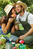 Happy gardening couple kissing Stock Photos