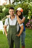 Happy gardening couple smiling outdoors Royalty Free Stock Photos