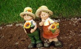 Happy gardening figures Royalty Free Stock Image