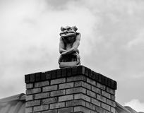 Gargoyle on rooftop Stock Photos