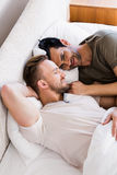 Happy gay couple lying on bed Royalty Free Stock Images