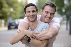 Happy gay couple outdoors stock image