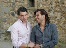 Happy gay couple taking a walk royalty free stock photo