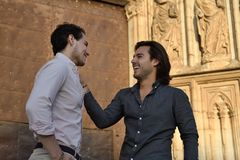 Happy gay couple talking relaxed royalty free stock photos