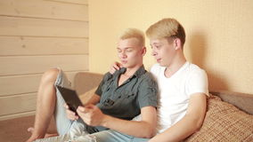 Happy gay couple using tablet in bed. gay couple stock video footage