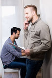 Happy gay couple working Royalty Free Stock Photography