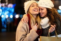 Happy gay women couple having fun and shopping at Christmas. Sale people happiness concept