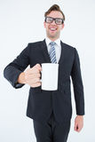 Happy geeky businessman holding coffee mug Royalty Free Stock Image