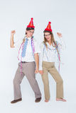 Happy geeky couple dancing Royalty Free Stock Image