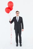 Happy geeky hipster businessman holding balloons Stock Photos