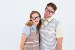 Happy geeky hipster couple with silly faces Royalty Free Stock Photos