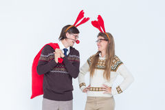 Happy geeky hipster couple with stag headband Stock Photos