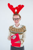 Happy geeky hipster opening present Stock Images
