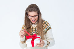 Happy geeky hipster opening present Royalty Free Stock Image