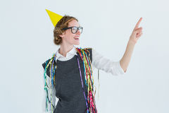 Happy geeky hipster pointing something Stock Photography