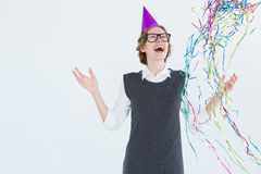 Happy geeky hipster wearing a party hat Royalty Free Stock Photography