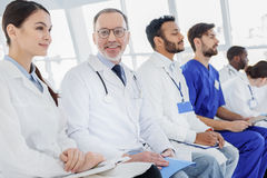 Happy general practitioners listening to new information Royalty Free Stock Photos