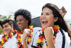 Happy german soccer fans about a goal of national team stock photos