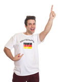 Happy german sports fan with black hair Royalty Free Stock Photo