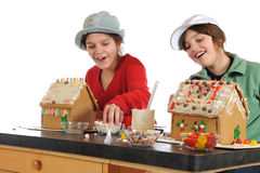 Happy Gingerbread House Makers Stock Photos
