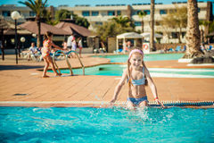 Happy gir in the pool Royalty Free Stock Image